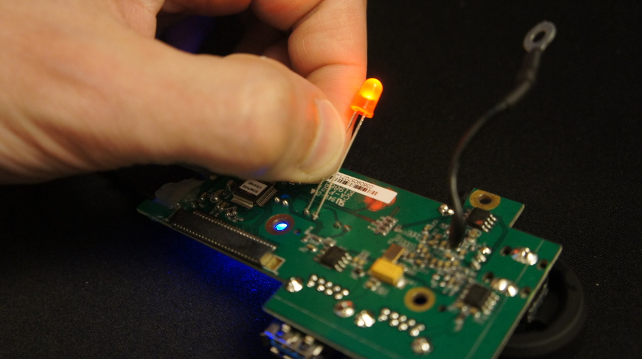 Applying an LED to the circuit board and watching it light up